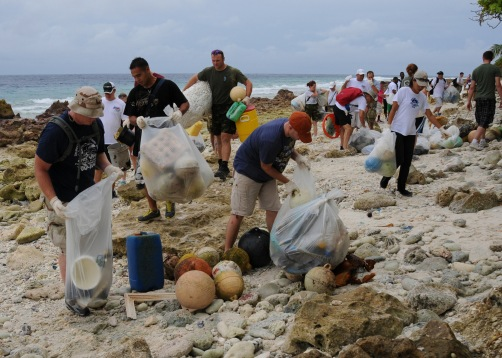 Sailors clean a beach in Diego Garcia.